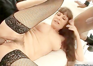 Brunette milf goes crazy getting fucked by three