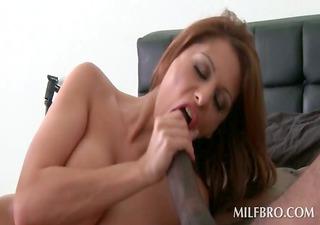 Mature redhead sucks and fucks black dick