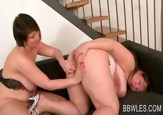 Mature BBW lesbian fucks a strap-on