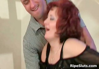 Mature redhead with big boobs gets that part1